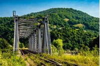 old metal rail road bridge in rural area of carpathian mountains