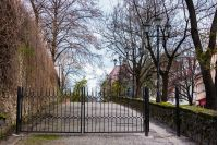 metal gates on the street of old town. lovely scenery with lanterns. location Zhupanatska street, Uzhgorod, Ukraine