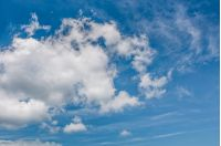 puffy cloud motion on a blue summer sky. beautiful weather background with dynamic cloud arrangement