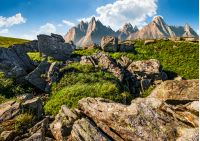 composite image of rocky peaks and rocks on hillside in High Tatras. Amazing mountain landscape in summer time