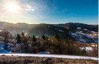 sunny day in Carpathian mountains. lovely winter landscape with small amount of snow