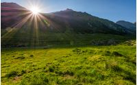 sunrise in valley of transfagarasan mountains. beautiful carpathian nature