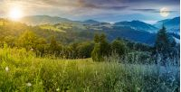 time change above panorama of a beautiful meadow in mountains. spruce trees on a hillside. rolling hills fall down in to the foggy valley in the distance. wonderful summer landscape with sun and moon