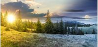 day and night time change concept above panorama of beautiful countryside in mountains. spruce trees on the meadow. top of the snow covered ridge in the distance with sun and moon