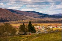 village in valley of Carpathian mountains. lovely springtime scenery on a cloudy day