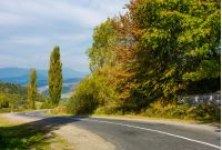 winding countryside road through mountains. lovely autumnal scenery