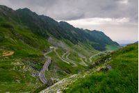 winding serpentine of the TransFagarasan road. beautiful transportation background. popular tourist destination in Romania