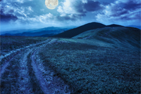 mountain landscape. path in valley  on the top of hillside at night in full moon light
