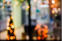 abstract background with bokeh effect of blurred warm lights in window of a shop