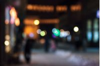 defocused background of city lights on street. lovely winter holidays concept.